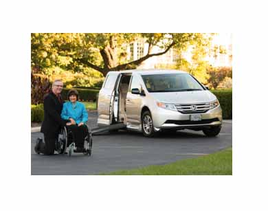 Universal Design 101 with Rosemarie Rossetti, Ph.D. sitting next to her Honda and her husband