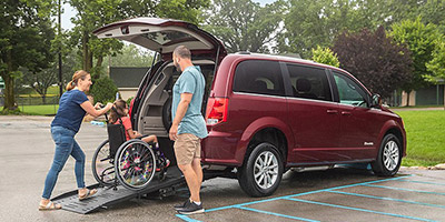 family with a BraunAbility dodge grand caravan Rear Entry wheelchair van