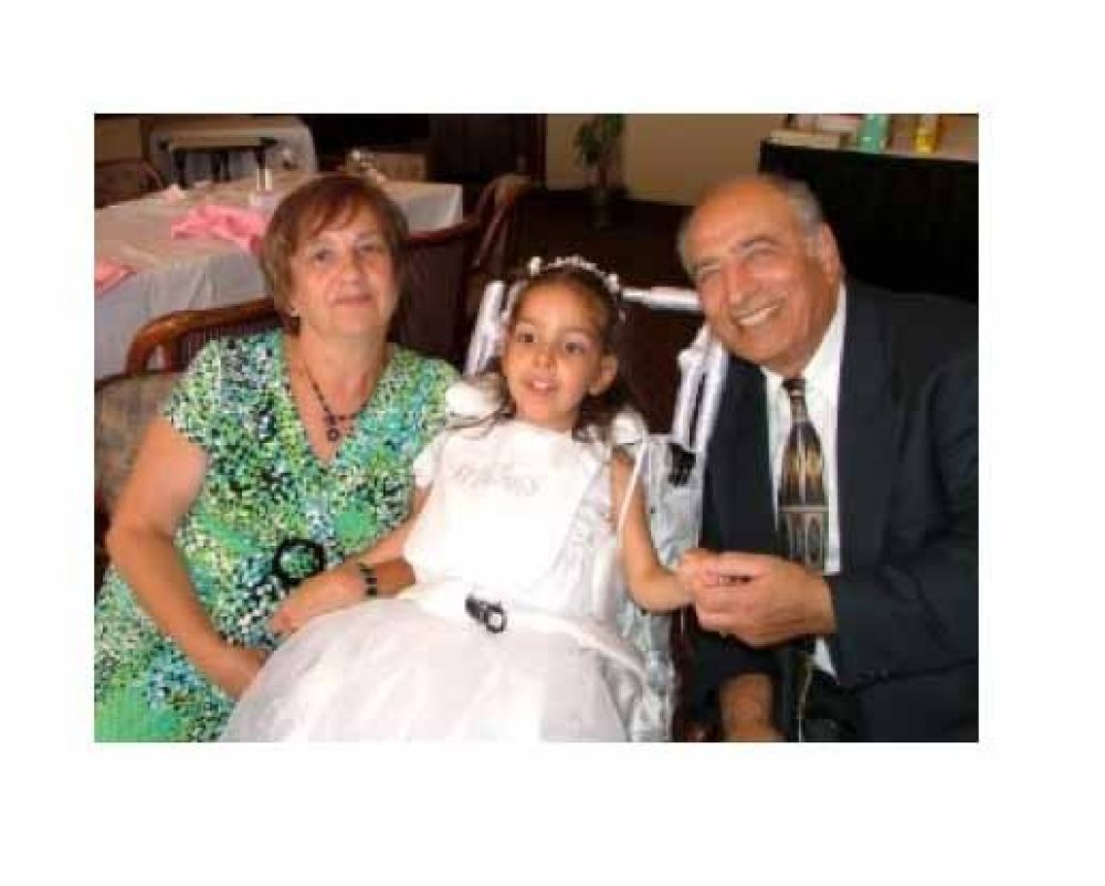 grandparents with their granddaughter who is in a wheelchair