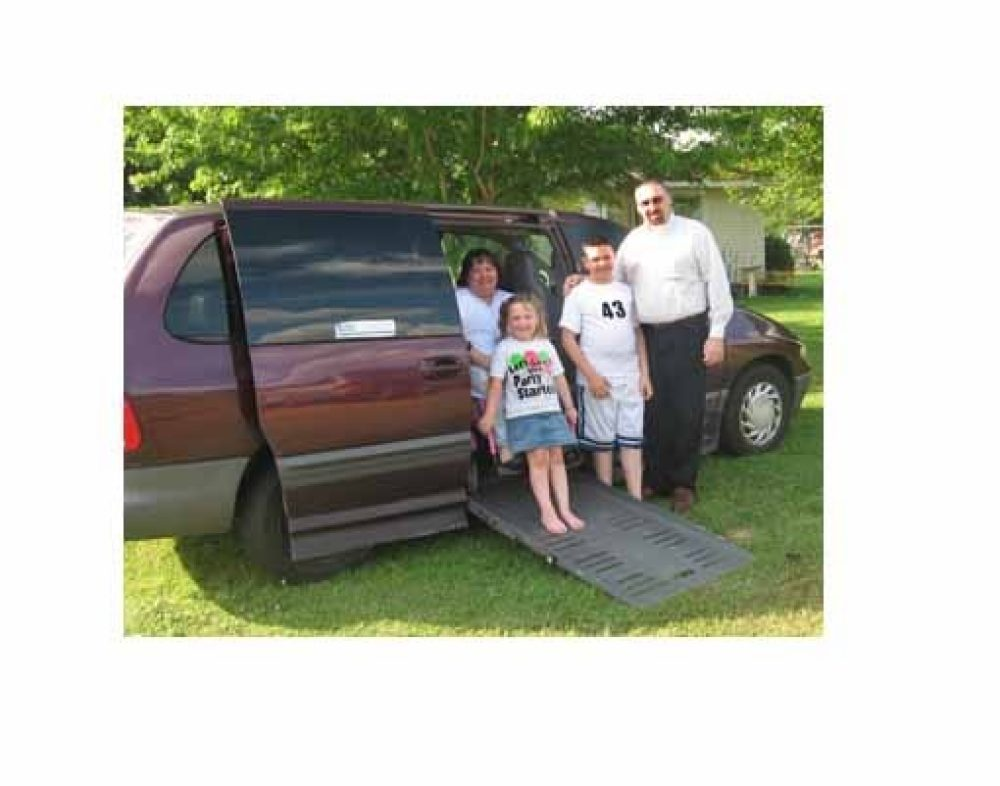 parents and their kids in a wheelchair van
