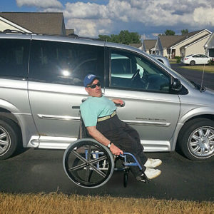 Tom Turner poses in front of his BraunAbility Entervan