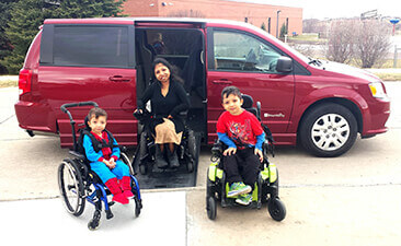 Three wheelchairs, one van: a mother and two sons with Jansen's Metaphyseal Chondrodysplasia