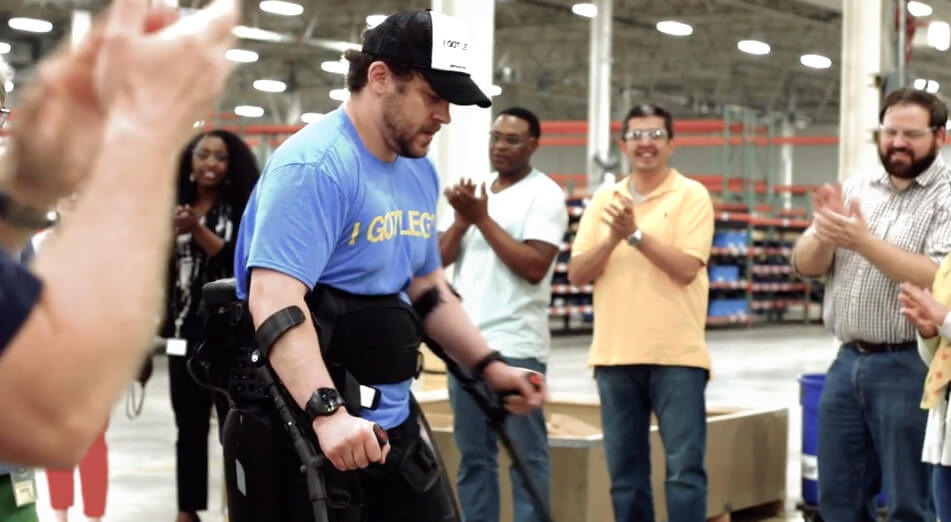 A man uses an exoskeleton to walk again after paralysis thanks to fundraising for mobility equipment