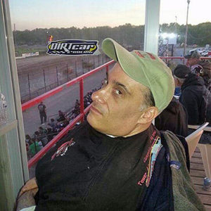Tom Turner, a longtime BraunAbility customer, at the racetrack