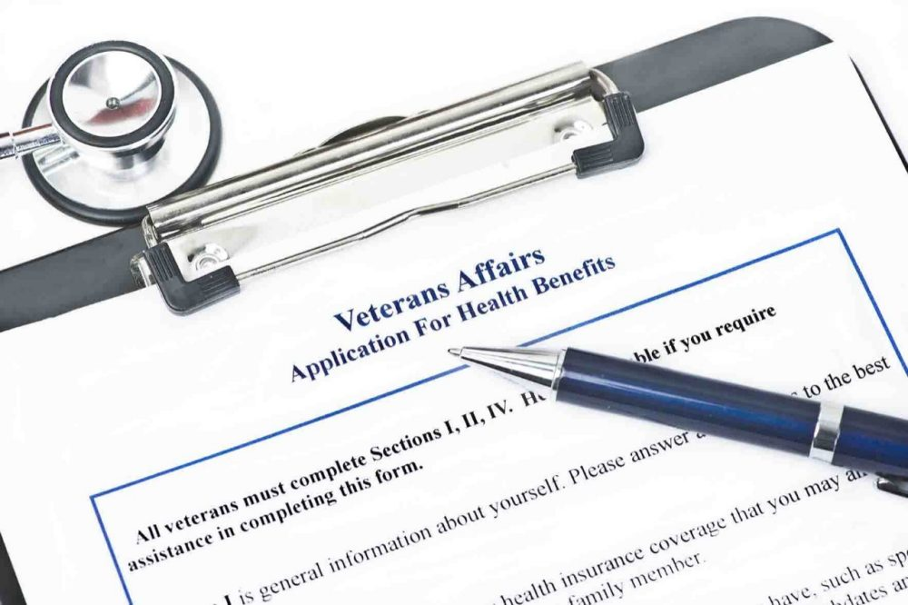 Application for Veteran Benefits on a clipboard