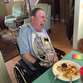 BraunAbility customer story: Kenny laughs at a dinner table