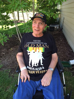 BraunAbility customer story: Vietnam Veteran, Kenny, smiles for the camera from his wheelchair