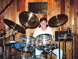 Jason Gerling as a young man with a drumset