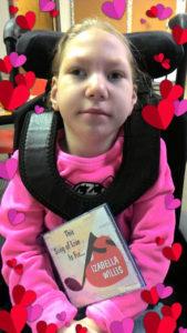 Izabella holds her Songs of Love CD written especially for her