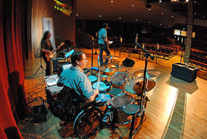 Jason Gerling playing on stage with a prototype kit