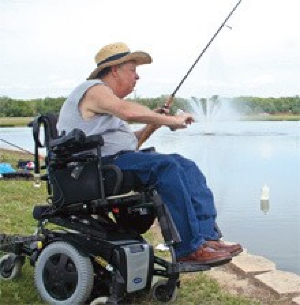 Man in power wheelchair fishing
