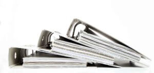 Stacked binders full or papers for funding an