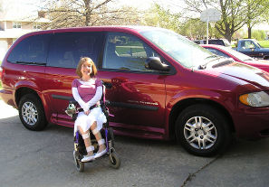 dream vehicle: red accessible BraunAbility entervan