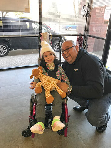 Father with a special needs daughter smiling