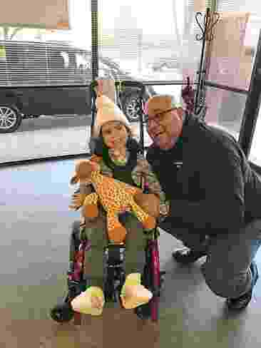 Father with a special needs daughter smiling|United Access of Carrollton, Texas donates a van conversion to a father of a special needs daughter
