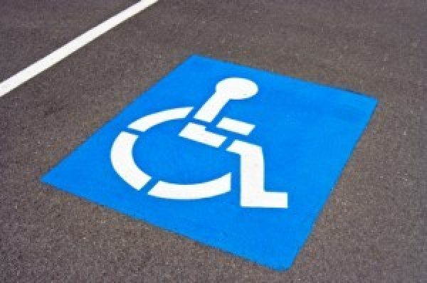 The History of the Little Blue Sign | Handicap Sign History