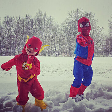 Two boys with Jansen's Metaphyseal Chondrodysplasia in superhero costumes