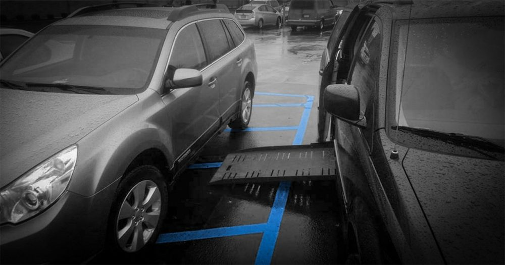 Car parked in access aisle which is blocking access to the handicap van