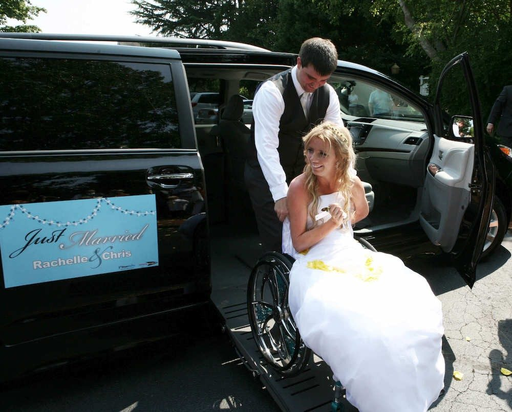 Rachelle Chapman is wheeled out of a BraunAbility vehicle by her new husband