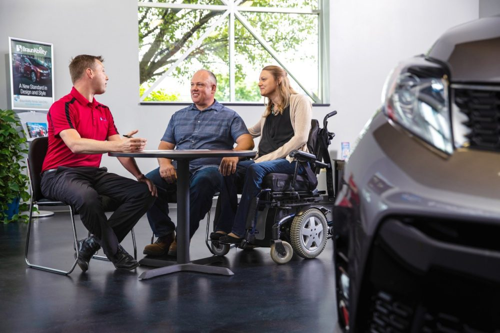 couple sitting at a mobility consultation working with a certified mobility consultant