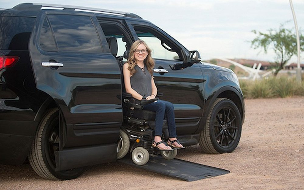 Girl sitting in a Wheelchair Accessible Ford Explorer mobility vehicle