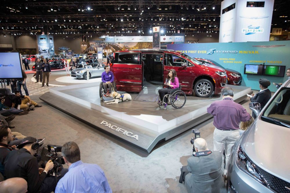 BraunAbility displaying a Chrsyler Pacifica Wheelchair Van at the Chicago Auto Show with Wallis and her service dog Mork
