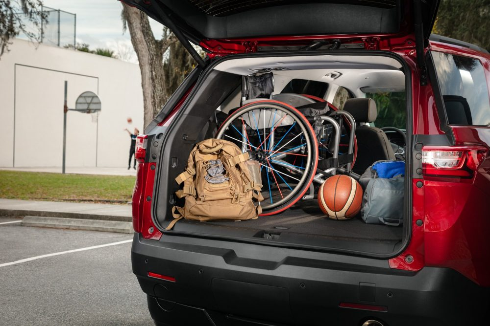 the rear of a chevy wheelchair suv full of things