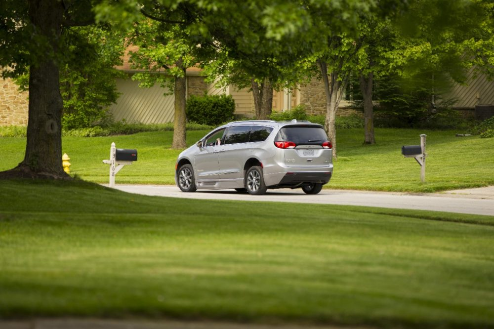 Chrysler Pacifica wheelchair van driving down a road