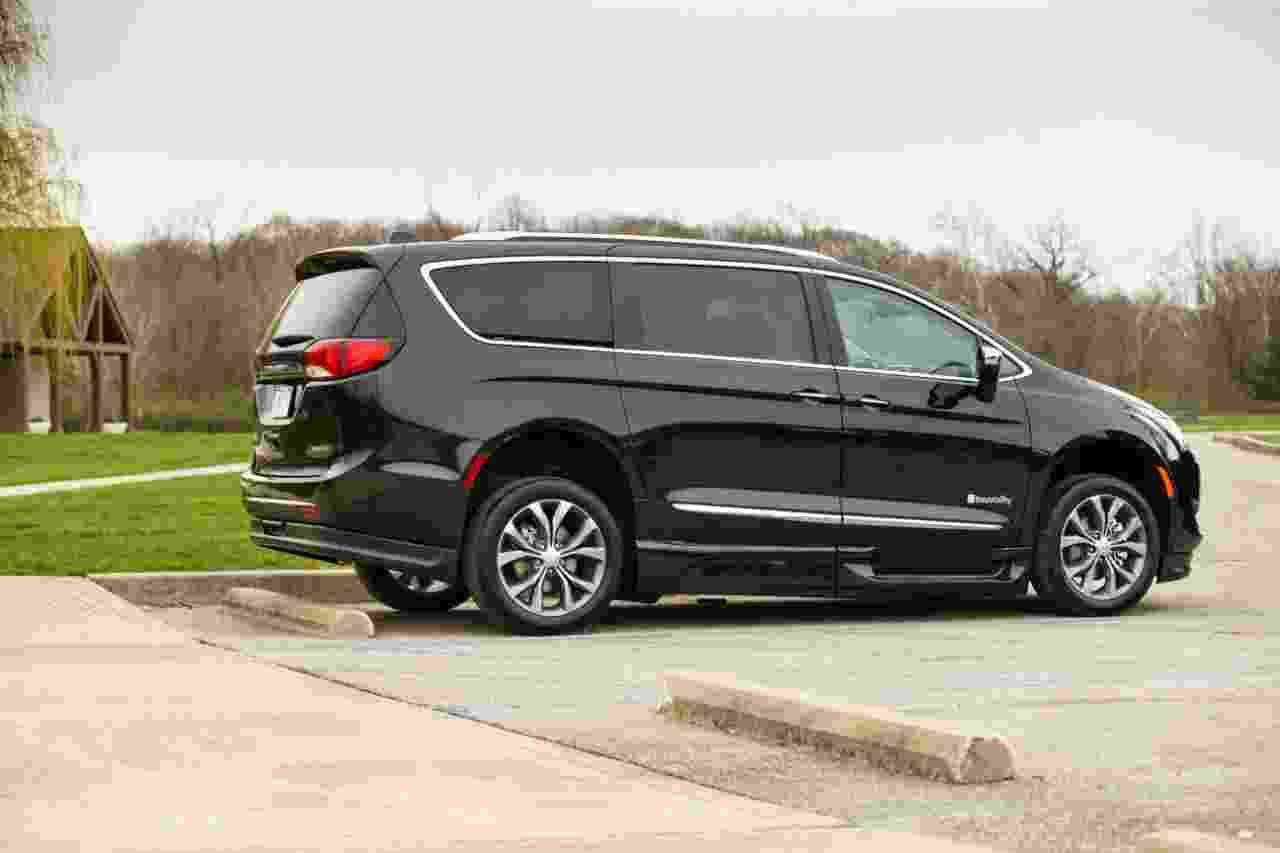 Black Chrysler Pacifica Handicap Van in parking lot