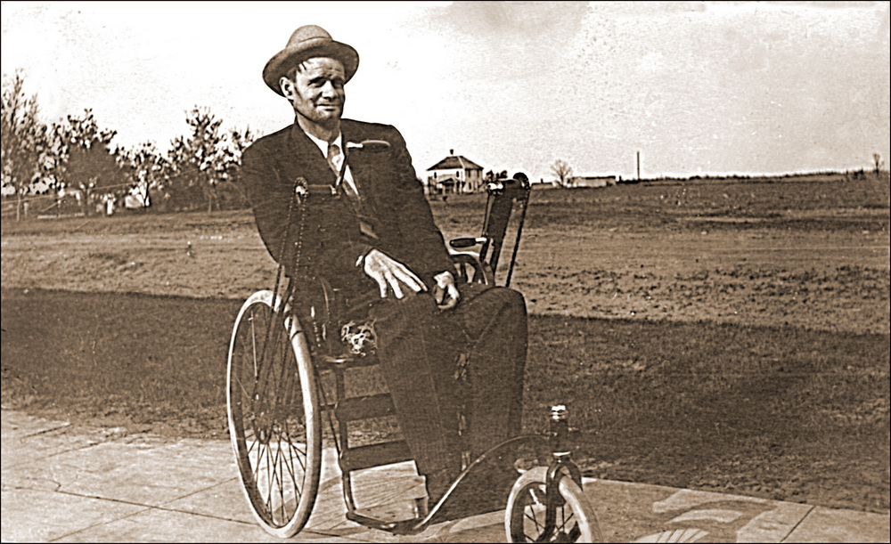 a vintage photo of a man in a wheelchair