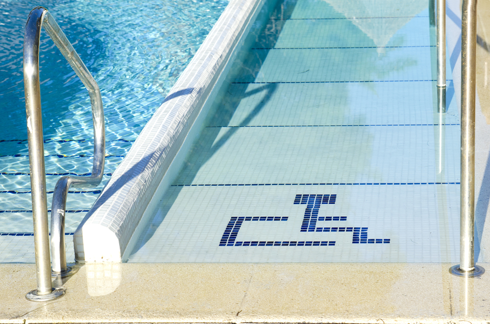 Access to swimming pool for handicap with handicapped symbol