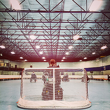 Goalie plays during a Michigan power hockey game|Michigan Mustangs prepare for national power hockey competition.
