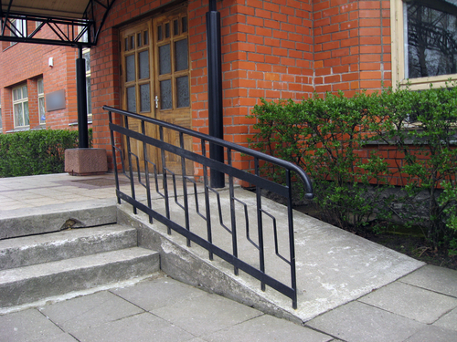 Building entrance with ramp for disabled person wheelchair