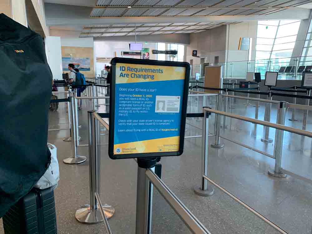 picture of a sign at an airport talking abut the REAL ID