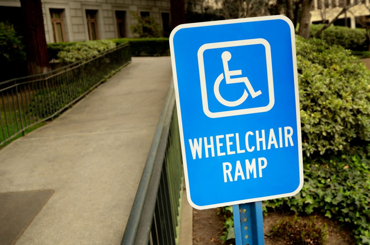 handicap wheelchair ramp sign outside by the building