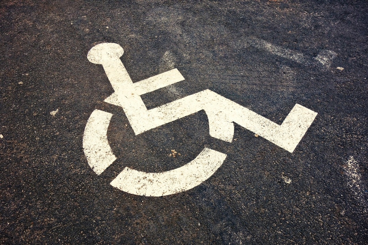 handicapped sign on pavement