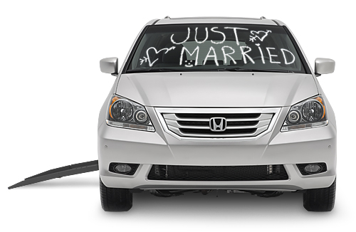"Wheelchair van with ""Just Married"" written on the windshield"