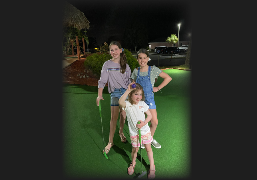 girls playing mini golf