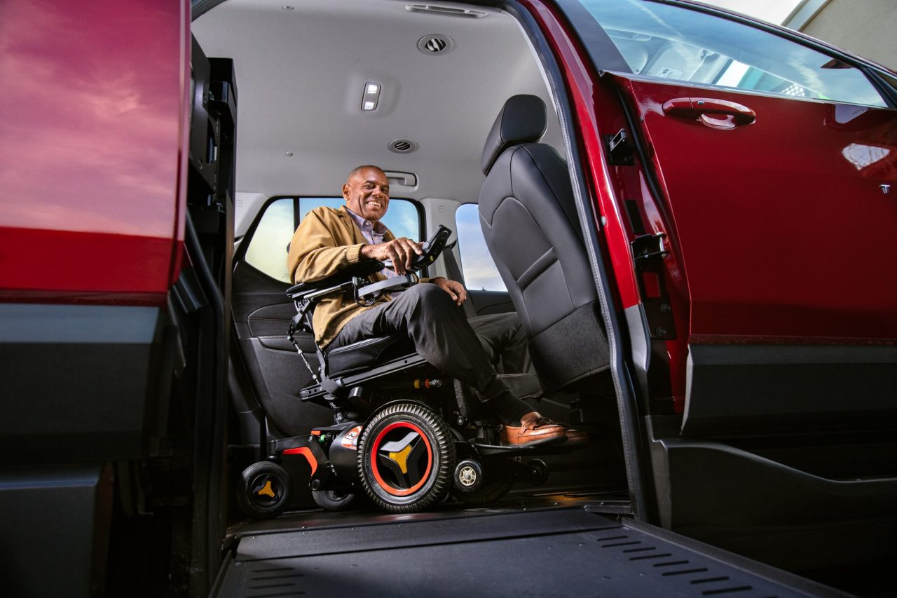 a man getting ready to drive his wheelchair SUV