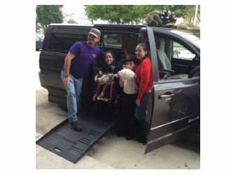 Lauren and her family pose by their new BraunAbility side-entry vehicle